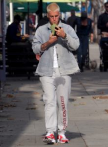 EXCLUSIVE: Justin Bieber walks down the street in West Hollywood with a large wet-spot on his sweatpants. The singer had just bought a juice from Earthbar and was walking along the street in West Hollywood looking at his phone, seemingly unaware of the embarrassing stain on his pants. 22 Feb 2017 Pictured: Justin Bieber. Photo credit: BLAK-OPS / MEGA TheMegaAgency.com +1 888 505 6342 (Mega Agency TagID: MEGA19311_003.jpg) [Photo via Mega Agency]